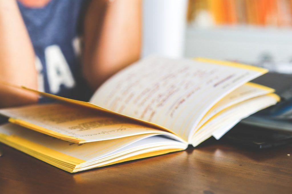 women reading a notebook
